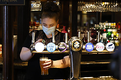 © Licensed to London News Pictures. 12/04/2021. London, UK.  Drinkers enjoy an early pint at the Fox on the Hill pub in south London. England begins the second phase of relaxing lockdown rules with pubs, restaurants and non-essential shops reopening. Photo credit: Peter Macdiarmid/LNP