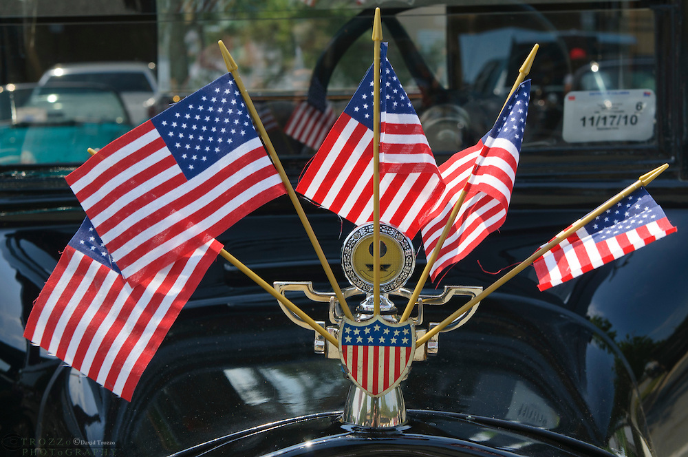Antique automobile with us flags