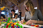Montana Shrader of Modulus works with a Zoob display during the Silicon Valley Business Journal's HHaaS Tech Mixer at ZERO1 in San Jose, California, on May 28, 2015. (Stan Olszewski/SOSKIphoto for the Silicon Valley Business Journal)