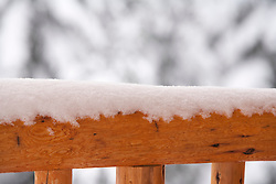 North America, United States, Washington, Crystal Mountain, snow on wood railing