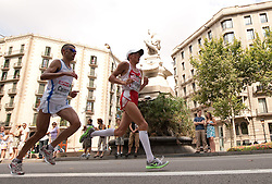 Daniele Caimmi of Italy and Guenther Weildlinger of Austria compete in the Mens Marathon during day six of the 20th European Athletics Championships at the roads of city Barcelona on August 1, 2010 in Barcelona, Spain. (Photo by Vid Ponikvar / Sportida)