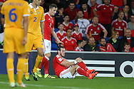 Gareth Bale of Wales © holds his leg after taking a knock.  Wales v Moldova , FIFA World Cup qualifier at the Cardiff city Stadium in Cardiff on Monday 5th Sept 2016. pic by Andrew Orchard, Andrew Orchard sports photography