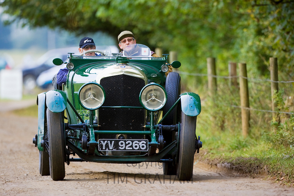 Vintage Bentley convertible sports car being driven in Charlton Park, Wiltshire, UK