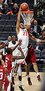 CHARLOTTESVILLE, VA- NOVEMBER 13: Mike Scott #23 of the Virginia Cavaliers dunks the ball next to South Carolina State Bulldog defenders during the game on November 13, 2011 at the John Paul Jones Arena in Charlottesville, Virginia. Virginia defeated South Carolina State 75-38. (Photo by Andrew Shurtleff/Getty Images) *** Local Caption *** Mike Scott