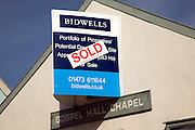 Bidwells estate agents Sold sign on former Gospel Chapel building, Wickham Market, Suffolk, England