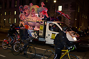 Cyclists and a political parody in Westminster before the result of MPs Meaningfull Brexit vote which eventually brought about a massive defeat for Prime Minister Theresa Mays Conservative government, on 15th January 2019, in Westminster, London, England.
