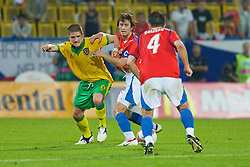 TEPLICE, CZECH REPUBLIC - SATURDAY, SEPTEMBER 2nd , 2006: Wales' Carl Robinson and Czech Republic's Tomas Rosicky during the opening UEFA Euro 2008 Group D qualifying match at the Na Stinadlech Stadium. (Pic by David Rawcliffe/Propaganda)