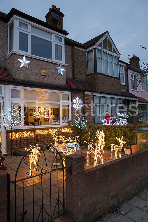 Christmas lights decorate the exterior of a house and front garden on the 10th December 2018 in South London in the United Kingdom.