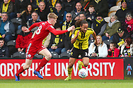 Burton Albion goes past Accrington Stanley defender Harvey Rodgers (18) during the EFL Sky Bet League 1 match between Burton Albion and Accrington Stanley at the Pirelli Stadium, Burton upon Trent, England on 23 March 2019.