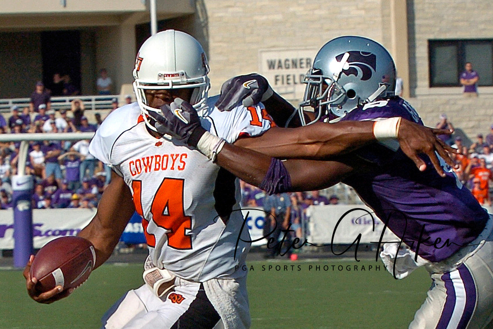 Kansas State defensive back Byron Garvin (R) grabs Oklahoma State quarterback Bobby Reid's (L) face mask while making a tackle in the first half, at Bill Snyder Family Stadium in Manhattan, Kansas, October 7, 2006.  The Wildcats beat the Cowboys 31-27.<br />