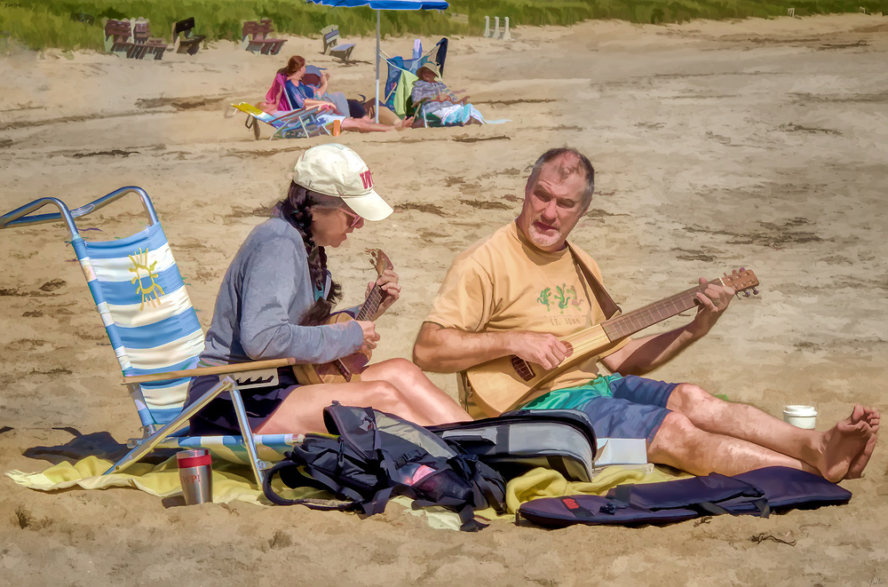 A couple, man and woman playiing stringed instruments on the beach, coffee ready at hand.