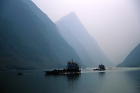 Cargo boats ply the Three Gorges on the Yangzte river filled with goods.