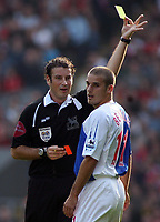 Photo: Paul Thomas.<br /> Liverpool v Blackburn Rovers. The Barclays Premiership. 14/10/2006.<br /> <br /> Referee Mr M. Clattenburg gives Blackburn player David Bentley a yellow card.