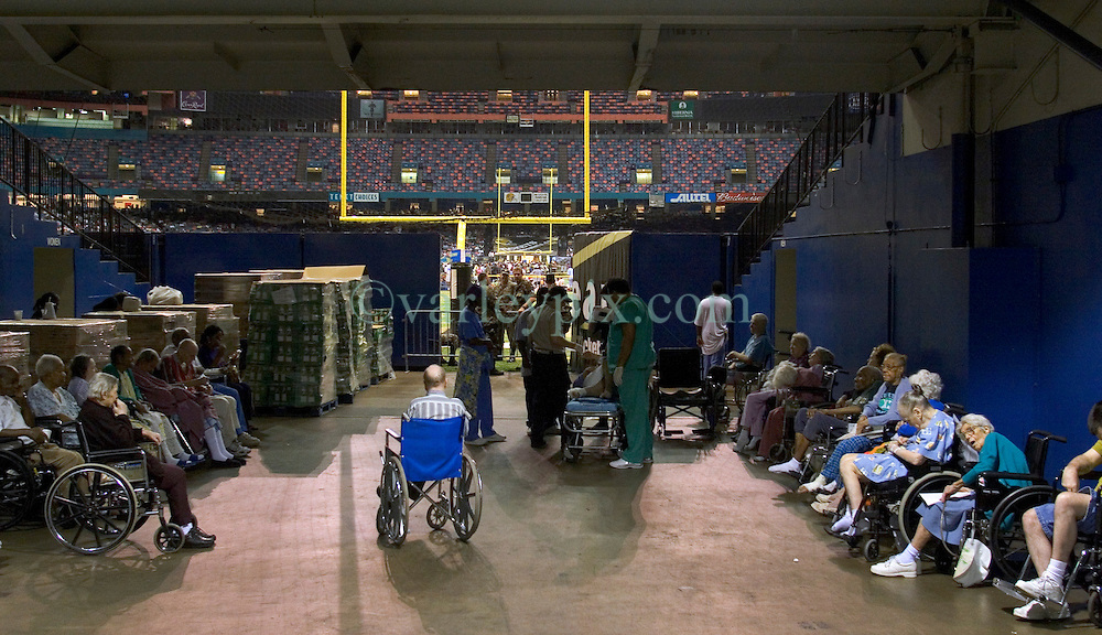 28th August, 2005. Hurricane Katrina, New Orleans, Louisiana. Thousands of people seek shelter inside the New Orleans Saints' Superdome the night before the storm hit. Elderly and infirm  residents of nursing homes and hospitals that did evacuate found themselves placed to the side of the a main entrance to the playing surface.