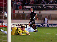 Photo: Alan Crowhurst.<br />MK Dons v Swansea. Coca Cola League 1.<br />13/09/2005. Andy Robinson scores his second goal for Swansea.