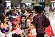 Mar. 9, 2009 -- BANGKOK, THAILAND: People wait to board trains in the concourse area of Hua Lamphong Train station in Bangkok. The station is a Bangkok landmark. It was designed by Dutch architects in the years before World War I. Trains from the station serve cities throughout Thailand. Photo by Jack Kurtz / ZUMA Press