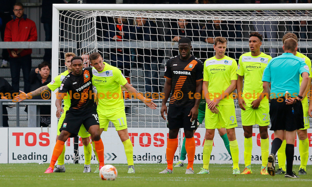 Barnet's Jean-Loius Akpa Akpro makes a nuisance of himself in the wall during the Sky Bet League 2 match between Barnet and Colchester United at Underhill Stadium in London. September 17, 2016.<br /> Carlton Myrie / Telephoto Images<br /> +44 7967 642437