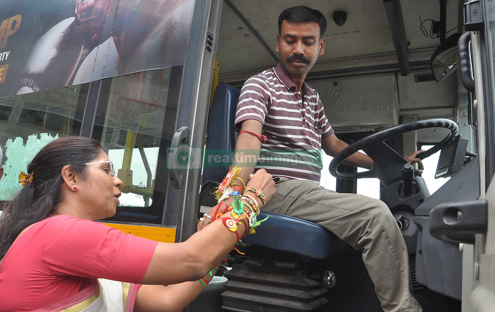 August 7, 2017 - Kolkata, West Bengal, India - Minister Sashi Panja ties rakhi to person with disabilities during Rakshabandhan Festival in Kolkata.  Minister Sashi Panja tie rakhi to bus driver during Raksha bandhan Festival in Kolkata. West Bengal Minister of Women & Child Development and Social Welfare (Independent Charge), Sashi Panja takes part in Raksha bandhan Festival with person with disabilities on August 7, 2017 in Kolkata. (Credit Image: © Saikat Paul/Pacific Press via ZUMA Wire)