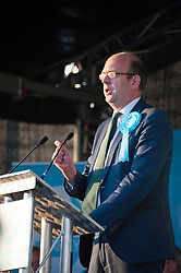 © Licensed to London News Pictures. 15/05/2019. Merthyr Tydfil, Powys, Wales, UK. Mark Reckless, Leader of the Brexit Party in the National Assembly for Wales, speaks at an open-air Brexit Party rally which takes place at Trago Mills in the Welsh, former mining town, of Merthyr Tydfil in Powys, UK. The Brexit Party was founded by former UKIP economics spokeswoman, Catherine Blaiklock in January 2019 to support the winning Brexit vote in the 'Leave or Remain' referendum of 23rd June 2016. Brexit Party members point out that the UK prime minister, Theresa May, has betrayed her electorate by not keeping her pledge that the UK would leave the European Union on March 29th 2019, the date set by invoking article 50 of the Treaty of Lisbon. Photo credit: Graham M. Lawrence/LNP
