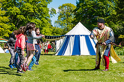 Medieval Day. Dirleton Castle, East Lothian, Scotland, United Kingdom, 11 May 2019. Pictured:  Medieval Day:  Historic Environment Scotland family fun day at the Living Medieval Village in the castle gardens. Children learn to march in an army.<br /> Sally Anderson   EdinburghElitemedia.co.uk