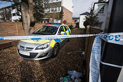 © Licensed to London News Pictures. 07/03/2018. Twickenham, UK. A crime scene remains in place and police continue to guard a property on South Road in Twickenham, south London where the body of a woman in her 40s was found with stab wounds on Monday evening. An hour earlier he bodies of two young boys, aged 7 and 10, and their father, were discovered at the foot of Birling Gap cliffs on the south coast, in what is suspected to be a murder suicide. Photo credit: Ben Cawthra/LNP