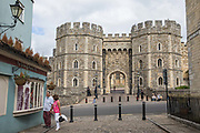 Visitors browse shop windows in view of the Henry VIII Gateway of Windsor Castle on 23rd August 2020 in Windsor, United Kingdom. The Sunday Times has reported that the Queen will make Windsor Castle her main home for the rest of the year following her summer break at Balmoral rather than returning to Buckingham Palace because her household arrangements at Windsor Castle are believed to offer the greatest protection from COVID-19.