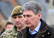 © Licensed to London News Pictures. 09/03/2012. Copedown Hill, UK. Secretary of Defence Philip Hammond pictured with Brigade Commander, Brigadier Doug Chalmers,  visits troops during the day. The 12th Mechanized Brigade (12 Mech Bde) at Copehill Down, Salisbury Plain Training Area, Wiltshire, on FRIDAY 09 MARCH 2012, as it prepares to deploy to Helmand Province, Afghanistan, on Operation Herrick 16, in the Spring of this year. The Brigade were performing a dynamic demonstration of combined Afghan/ISAF operations supported by surveillance assets and casualty evacuation capability. Tornado GR4 fast jest ground support was also displayed.. Photo credit : Stephen SImpson/LNP