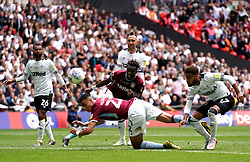 Aston Villa's Anwar El Ghazi (centre, floor) scores his side's first goal of the game during the Sky Bet Championship Play-off final at Wembley Stadium, London.