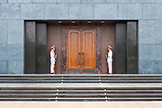 Military honor guards at the entrance to the Ho Chi Minh Mausoleum in Hanoi, Vietnam.