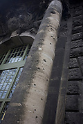 The blackened and ricochet-scarred stonework of an old building dating from before the second world war, marked during the battle for the city during the fall of the Third Reich, the end of Nazi fascism in the spring of 1945.