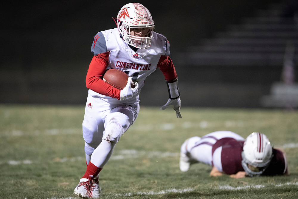 Constantine's Brayden Clark runs with the ball for yardage during the Constantine-Buchanan high school football game on Friday, November 13, 2020, at Memorial Field in Buchanan, Michigan.