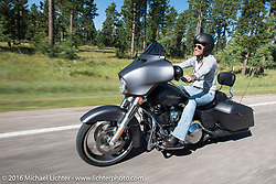 Harley-Davidson employee Jodi Searle riding a full dresser on the Harley-Davidson Angels Ride to benefit the Nature Conservancy during the annual Sturgis Black Hills Motorcycle Rally.  SD, USA.  August 12, 2016.  Photography ©2016 Michael Lichter.