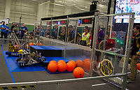 """Emma Savoie does the driving for the Gilford """"Screaming Eagles"""" (team 1831) with team mates Katrina Boucher, Neal Miller and Chas Townsend on deck in their qualifying round during the Governor's Cup FirstNH Robotic competition at PSU/All Well North complex on Saturday.  Team members not pictures:  Angie Bonnell, Madi Lemire, Dave Patel and Kat Mitchell.   (Karen Bobotas/for the Laconia Daily Sun)"""