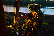 Tarakan, 15, a girl participating to the ultra-nationalistic Azovets children's camp, is collecting flowers for celebrations of Ivan Kupala Day, a folkloristic tradition relating to solstice and fertility, on the banks of the Dnieper river, in Kiev, Ukraine's capital.