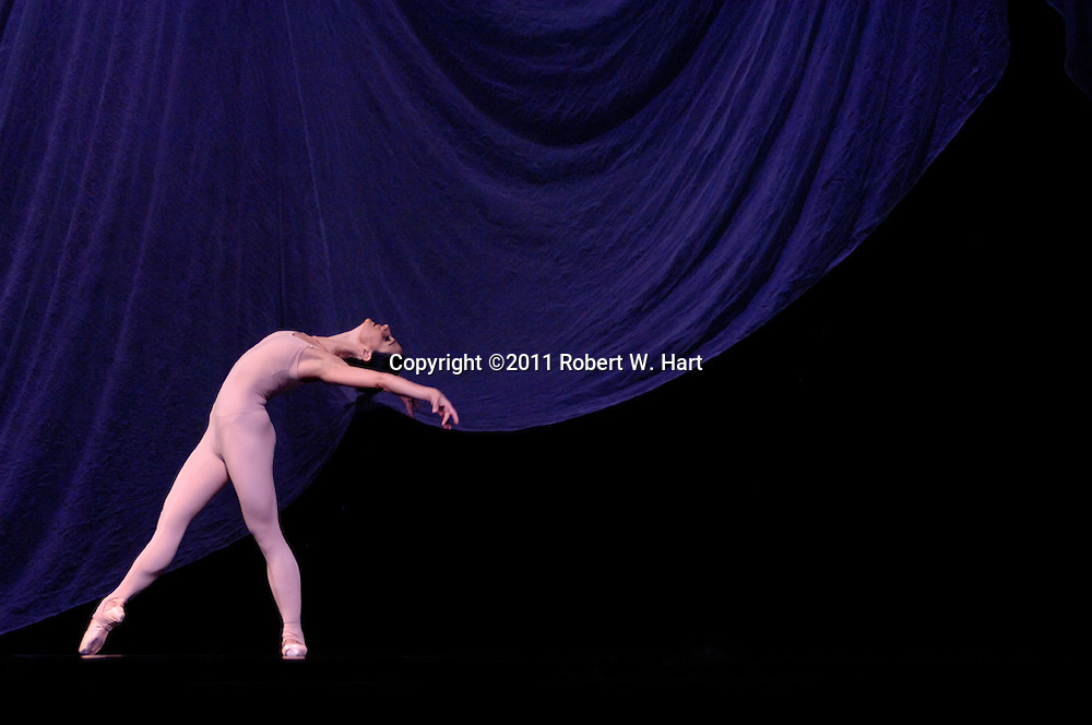 """A Texas Ballet Theater dancer performs Ben Stevenson's """"Four Last Songs"""" during a February 17, 2011 dress rehearsal at Fort Worth's Bass Hall."""