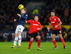 Man Utd Forward Wayne Rooney (ENG) heads during the second half of the match - Photo mandatory by-line: Rogan Thomson/JMP - Tel: Mobile: 07966 386802 - 24/11/2013 - SPORT - FOOTBALL - Cardiff City Stadium - Cardiff City v Manchester United - Barclays Premier League.