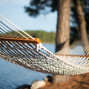 A hammock strung up between trees on the waterline of Maryland's Eastern Shore.