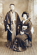 traditional young couple wedding studio portrait Japan ca 1920s
