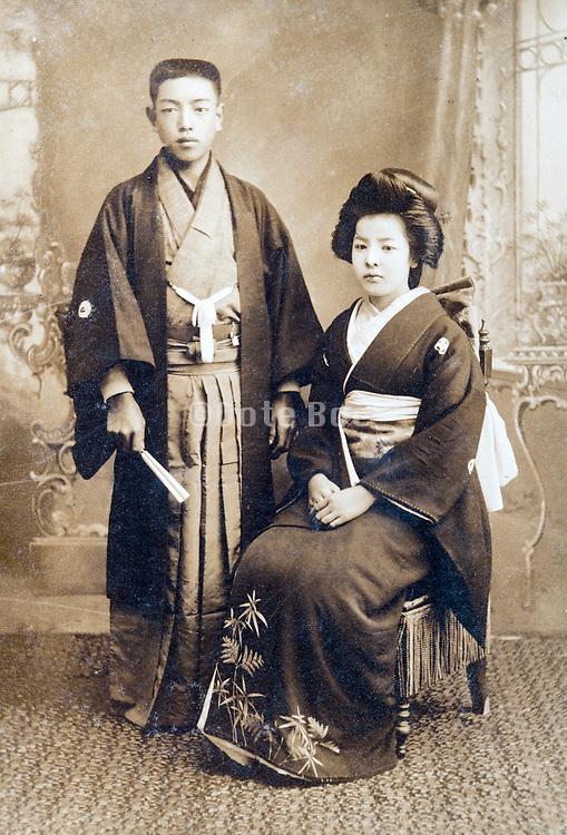 traditional young couple wedding studio portrait Japan ca 1920s