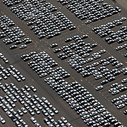Aerial footage of Port Newark captured from a helicopter shows automobiles sitting in parking lots during the Coronavirus (Covid-19) outbreak on Monday, June 1, 2020 in New York City. (Alex Menendez via AP)