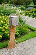 Hand made wooden information box with leaflets about the garden by the Herbaceous borders (area 15 on map) in the Victorian Walled Garden at Kylemore Abbey. Only plants and flowers that were introduced to Ireland before 1901 are used in the gardens. The 6 acre garden is to the west of the Abbey originally known as a castle when it was built by Mitchell and Margaret Henry in the 1850's. The garden is on a south slope at the foot of Duchruach Mountain and facing Diamond Hill. It was chosen as the warmest and brightest spot on the estate with a mountain stream providing water. It is now a Benedictine community; open seven days a week all year round. The Abbey is located in Connemara in the west of Ireland. August