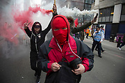 Anarchists gather as a black bloc letting off smoke bombs for the Fuck Parade to party and protest at the class and wealth divide between rich and poor and the gentrification of London, the demonstration was organised by anarchist group Class War on May 1st 2016 in London, United Kingdom. The parade is now part of the May Day activism calendar as dissatisfaction about the establishment, the police and the inadequacy of the press is highlighted. (photo by Mike Kemp/In Pictures via Getty Images)