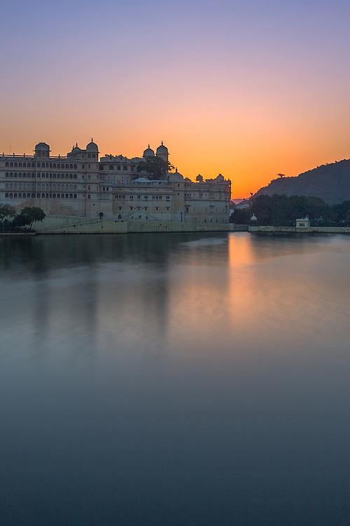 A beautiful sunrise over Udaipur's City Palace,  as seen from the floating Taj Lake Palace Hotel.