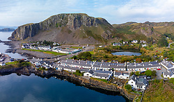 Aerial view from drone of former slate quarry and village of  Ellenabeich at Easdale on Seil Island, one of the slate islands, Argyll and Bute, Scotland, UK
