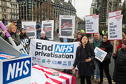 London, UK. 25 November, 2019. Heidi Chow of Global Justice Now addresses campaigners from Keep Our NHS Public, Health Campaigns Together, We Own It and Global Justice Now at a protest in Parliament Square to call on Prime Minister Boris Johnson to end privatisation of healthcare in the National Health Service (NHS).