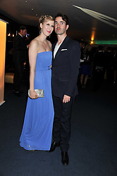 JIMMY CARR and his wife KAROLINE at the GQ Men of the Year 2011 Awards dinner held at The Royal Opera House, Covent Garden, London on 6th September 2011.