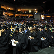 Students watch as President Bill Clinton addresses graduates of UCF's College of Health and Public Affairs and the College of Medicine's Burnett School of Biomedical Sciences at the UCF Arena on Thursday, May 2, 2013 in Orlando, Florida. Clinton was also awarded an honorary degree that  recognizes his service as president and also his service as a humanitarian and international ambassador since he left office. This is his third visit to the UCF campus and he will be the second U.S. president to speak at a UCF graduation ceremony. President Richard M. Nixon addressed graduates in 1973.  (AP Photo/Alex Menendez)
