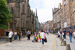 Edinburgh, Scotland, UK. 6th August  2021.  Images from the Royal Mile in Edinburgh Old Town on the opening day of the Edinburgh Fringe Festival 2021.  The festival looks very different from two years ago . Very few street performance spaces are permitted and far fewer tourists are evident. Also a high police visibility, there are more police officers than performers on the street, is in marked contrast to previous years. Pic; The Royal Mile is very quiet on opening day of the Fringe.   Iain Masterton/Alamy Live news.