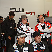 Dr. Wolfgang Porsche (middle) with Bernhard Maier, Member of the Board Porsche AG Sales and Marketing, on his left, watching the race on Sunday 23 June 2013 (Le Mans 24H)