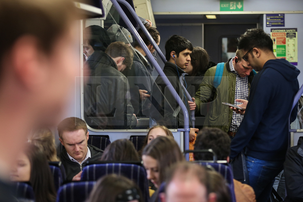 © Licensed to London News Pictures. 13/03/2017. Leeds, UK. Commuters packed onto a rain heading towards Leeds Train Station in West Yorkshire as a day of rail strikes begins. Members of the RMT union are to walk out today for 24 hours in protest at changes to their jobs. Photo credit : Ian Hinchliffe/LNP